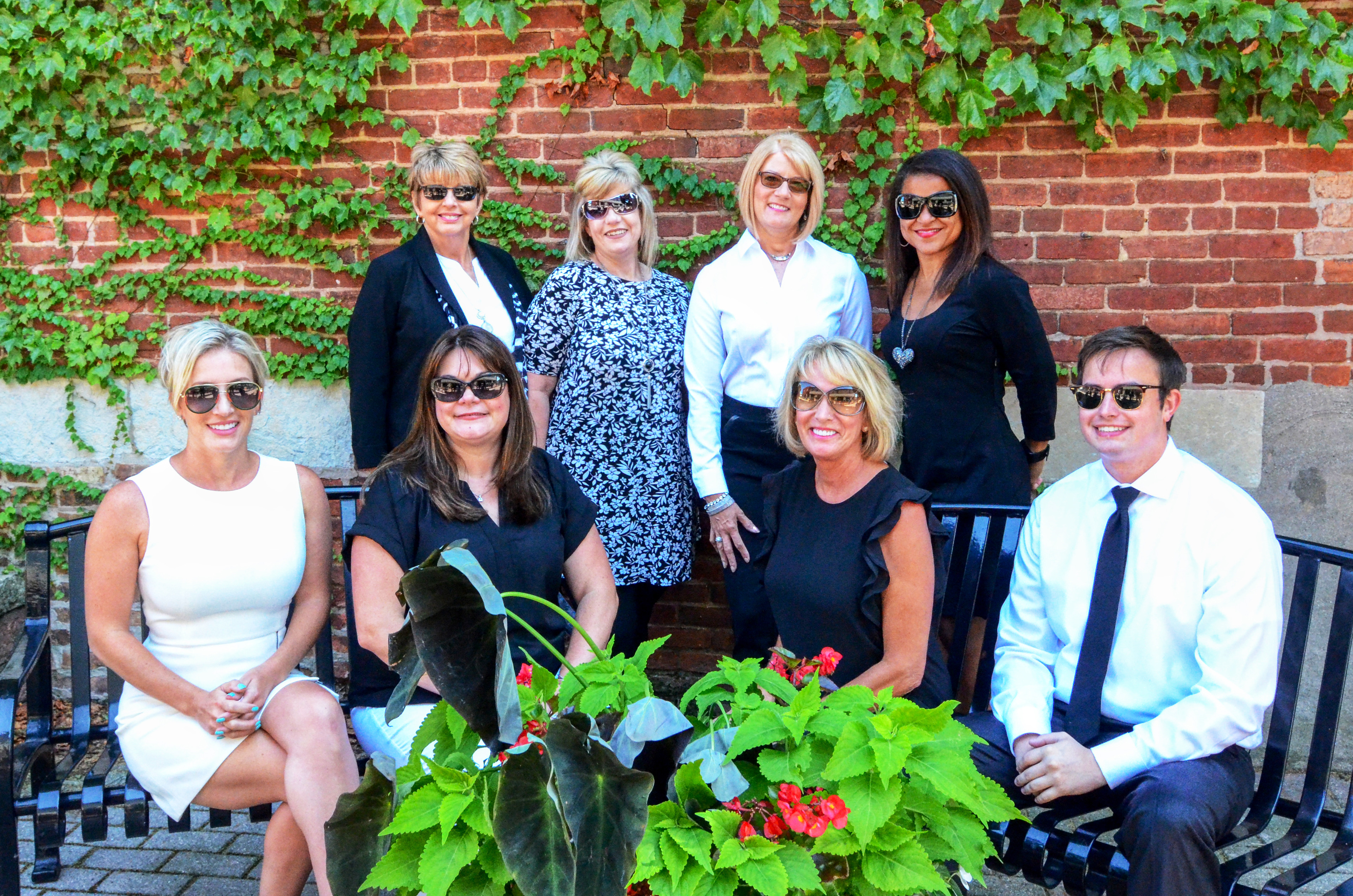 The Jana Caudill Team takes a photo wearing sunglasses to promote Crown Point Realtors.
